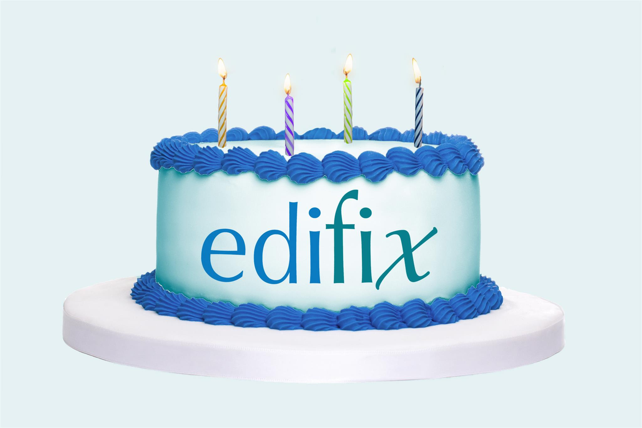 "Birthday cake with 4 candles on top and ""Edifix"" on the side"